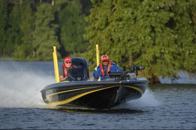 fast bass boat runs smooth across lake