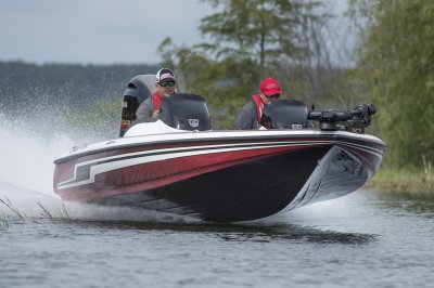 smooth riding bass boat speeds across lake