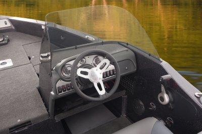 big cockpit area with wrap around windshield