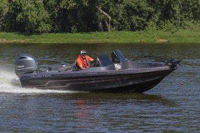 deep v walleye boat speeds across open water