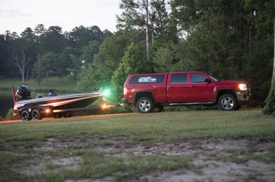 skeeter fx21 apex edition boat hooked up to red truck