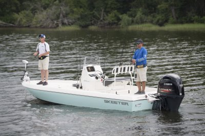 two men fishing from skeeter sx210