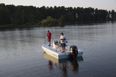 two men fishing from skeeter sx210 bay boat